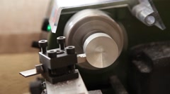 Precision lathe working on a aluminum piece - stock footage
