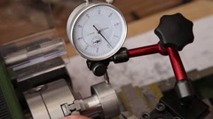 Man using micrometer clock precision dial test indicator gauge scale on lathe Stock Footage