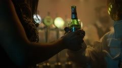 4K Funny astronaut relaxing in nightclub, drinking beer & chatting with girl - stock footage
