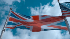 English flag on the flagpole waving in the wind against a blue sky with clouds Stock Footage