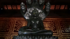 Black jade Buddha in Wat Chiang Man temple,  Chiang Mai, Thailand. Zoon out. Stock Footage