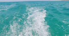 Speedboat wake prop wash at blue sea in a sunny day. - stock footage