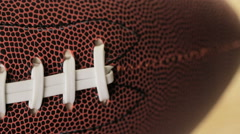 Close up of brown leather and white laces of American Football. Stock Footage