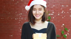 Portrait of thai adult student university beautiful girl hold gift box in hands Stock Footage
