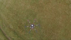 Aerial of drone hovering over green lawn Stock Footage