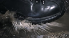 Black new and glossy boots step on a puddle. Slow mo, slo mo Stock Footage