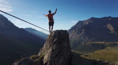 Aerial of man walking on slackline Stock Footage