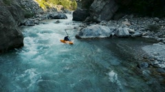 Aerial of man kayaking in beautiful river Stock Footage
