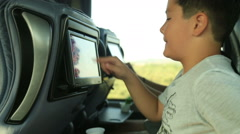 Child watching tv on the bus Stock Footage