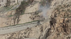 Israeli Soldiers shooting tear gas from Jeep car Stock Footage