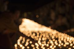 Blur image of people light candle to pay respect to buddha relic Stock Photos