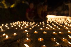 blur image of people light candle to pay respect to buddha relic - stock photo