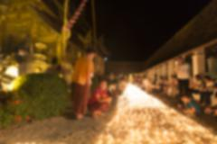 People light candle to pay respect to buddha relic - blur image Stock Photos