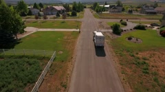 Aerial shot of a local sanitation truck lifting the garbage cans - stock footage