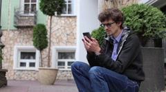 Young Man is Gaining Sms Message on the Phone Stock Footage