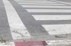 crosswalk zebra walkway across road - stock photo