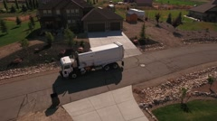 Aerial shot of garbage truck lifting garbage cans Stock Footage