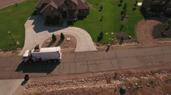 Aerial shot of garbage truck lifting the garbage cans Stock Footage