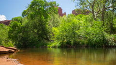 MoCo Tracking Time Lapse of Red Rock over River in Sedona -Long Shot- Stock Footage
