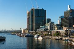 Darling Harbour promenade with views of Barangaroo skyscrapers Stock Photos