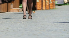 Slow motion. Feet  of woman in black  stockings on summer city street  - stock footage