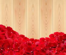 beautiful red rose petals on wooden planks texture close-up - stock photo
