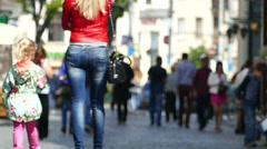 Slow motion. Sexual figure of mother and daughter on city street. Blurred scene  Stock Footage