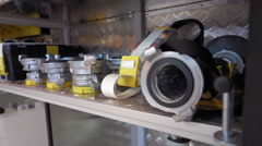 Fire extinguishing equipment stacked on the shelves of a fire truck Stock Footage