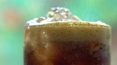 Cola with Ice and bubbles in glass, Stock Footage