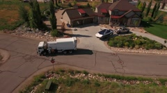 Aerial shot of sanitation truck lifting the garbage cans - stock footage