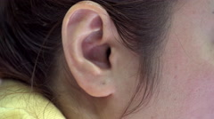 Close up of asian female ear . Stock Footage