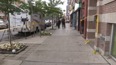 Police officers at shooting murder and crime scene in downtown Toronto Stock Footage