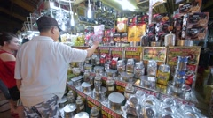 Man sells tea, coffee and dried fruit at the Ben Thanh Market Stock Footage