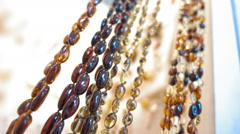 Beautiful amber beads and other jewelry in the shop Stock Footage