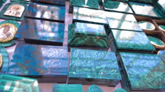 Beautiful malachite caskets reflected incident light as a mirror Stock Footage