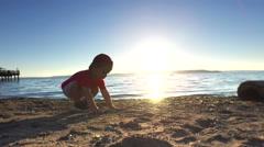 Boy running on the beach. Stock Footage