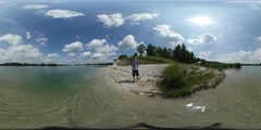 360Vr Video Man Tourist on Lake Bank Standing Near Turquoise Water Trees Person Stock Footage