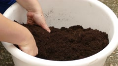 Housewife Mixing Soil For Planting Stock Footage