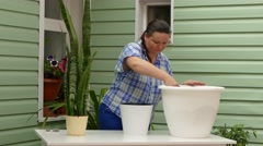 Woman Filling Pot With Soil Stock Footage