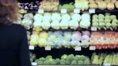 Young woman shopping in the yogurt section at the grocery store. Stock Footage
