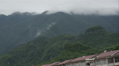 Timelapse of clouds over mountain village in China. Stock Footage