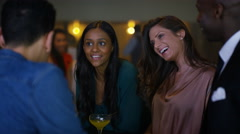 4K Guys & girls chatting & flirting together in trendy city bar Stock Footage