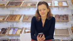 Young woman shopping in the yogurt section at the grocery store. Arkistovideo