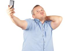 Funny picture of  plump man  businessman doing selfie. - stock photo