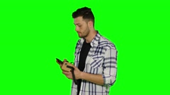 Virtual reality game. Boy uses head mounted display. Green screen Stock Footage