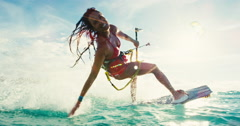 Woman Kiteboarding at Sunset Stock Footage
