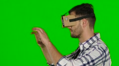 Man wearing virtual reality goggles. Green scree. Close up Stock Footage