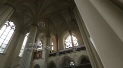Gothic style interior with arcs and decoration in Catholic cathedral Stock Footage