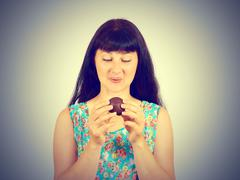 Young woman craving sweets chocolate, marshmallow - stock photo