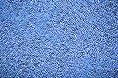 Conceptual shot of blue wallpaper with paint structure - stock photo